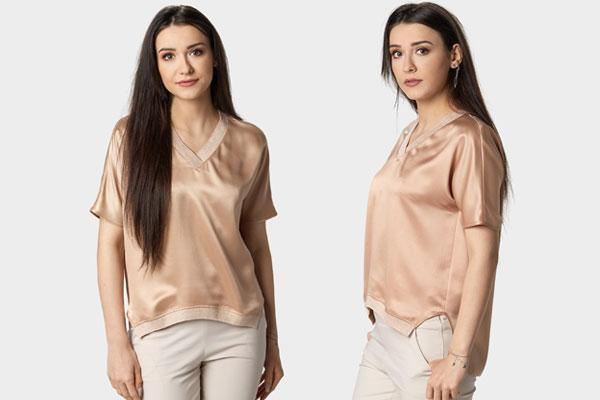 Satynowa asymetryczna bluzka nude zapewni błysk, który promują trendy wiosna 2018